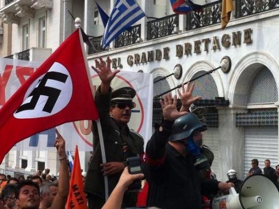 Ангела Меркель посетила Грецию - вот любопытное фото с демонстрации.